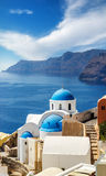 Churches of Oia village under puffy clouds, Santorini Royalty Free Stock Images