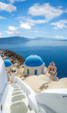 Churches of Oia village under puffy clouds, Santorini Royalty Free Stock Photo