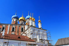 Churches restoration. Orthodox church in scaffolding for restoration Royalty Free Stock Photography