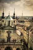 Churches and roofs of Old Prague, aged photo Stock Image