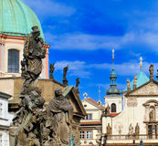 Churches and Statues. Partial view of the church of sv. Salvator and  statues of the sv. Frantisek Church, in Prague Stock Images