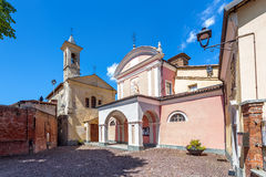 Churches on town square in Barolo. Stock Images