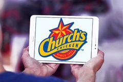 Churchs chicken logo. Logo of food franchise and restaurant churchs chicken on samsung tablet Stock Photo