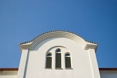 White church window against blue sky. Window of orthodoxy church in Paralia, Greece stock photography