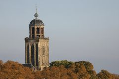 Churchtower behind colorful trees in autumn, Deventer, The Netherlands Stock Photography