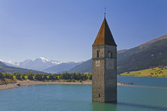 Churchtower in lake Reschen Stock Photos