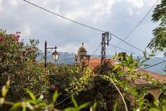 Churchtower, powerlines and bushes in Deir el Qamar, Lebanon royalty free stock photos