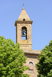 Churchtower Urbisaglia. Churchtower with trees in town Urbisaglia, Marche, Italy royalty free stock photography