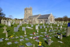 Village church and grave stones. The churchyard and church of Saint Mary in the village of Berrow in Somerset, England Stock Photo