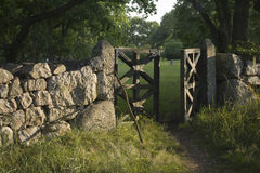 Churchyard gate. Old churchyard gate in setting sun Royalty Free Stock Photography