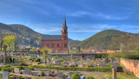Churchyard in Pfalz, Germany. Church with graveyard in Pfalz, Germany Stock Photos