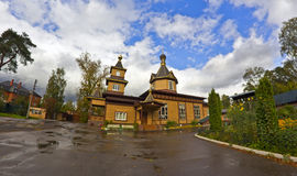 Churchyard after a rain. Church of St. apostles Peter and Paul in Malakhovka, Moscow area. Fish-eye lens Stock Photos