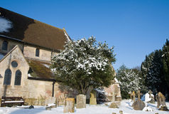 Churchyard in snow Stock Photography