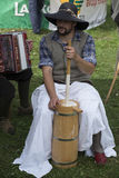 Churning butter traditionally. Bohinj, Slovenia - 9.20.2015: Man churning butter traditionally in Bohinj Cow Ball festival Stock Images