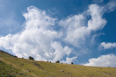 Churning Clouds Above a Vast Horizon Stock Images