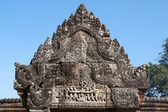 Churning of the Ocean of Milk bas relief on pediment at the 11th century Preah Vihear Temple complex Royalty Free Stock Images