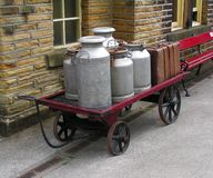 Churns. Milk churns on a cart Stock Images