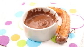 Churro and chocolate dip. Close up on churro and chocolate dip Royalty Free Stock Photo