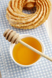 Churro donut and bowl of honey. Party dessert Royalty Free Stock Image