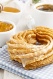 Churro donuts and bowl of honey. Spain dessert Royalty Free Stock Photo