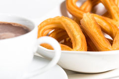 Churros avec du chocolat Photo stock