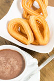 Churros avec du chocolat Images stock