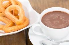 Churros avec du chocolat Photographie stock libre de droits