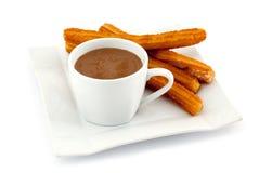 Churros avec du chocolat chaud Image libre de droits