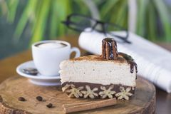 Churros cheesecake and macchiato coffee with book and glasses background royalty free stock images