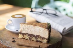 Churros cheesecake and macchiato coffee with book and glasses background stock image