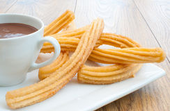 Churros with chocolate Stock Photos