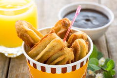 Churros and chocolate Stock Image