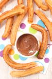 Churros and chocolate dip. Above Stock Images
