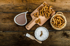 Churros with chocolate dip - Streed food, deep fried Royalty Free Stock Images