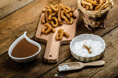 Churros with chocolate dip - Streed food, deep fried Stock Photography