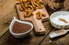 Churros with chocolate dip - Streed food, deep fried Stock Photos