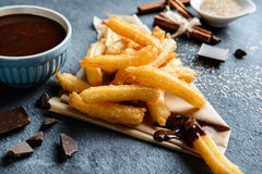 Churros with chocolate dipping sauce Royalty Free Stock Photo