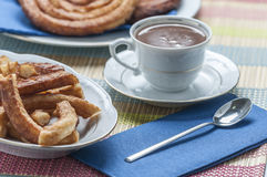 Churros with chocolate Royalty Free Stock Photo