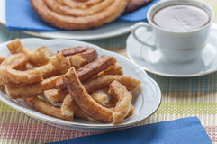 Churros with chocolate Royalty Free Stock Image
