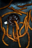 Churros with chocolate sauce Royalty Free Stock Image