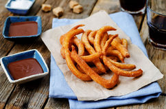 Churros with chocolate sauce Stock Photography