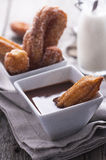 Churros with chocolate Royalty Free Stock Photography
