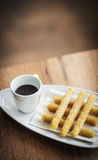 Churros and chocolate spanish donuts with sauce breakfast snack Royalty Free Stock Photography