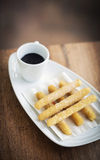 Churros and chocolate spanish donuts with sauce breakfast snack Stock Image
