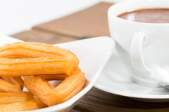 Churros with chocolate Royalty Free Stock Images