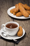 Churros with Chocolate on Wooden Table Royalty Free Stock Images