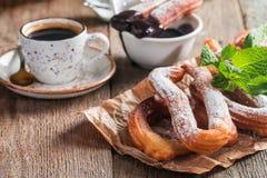 Churros, coffee and hot chocolate Stock Photos