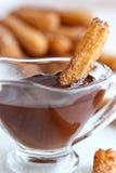 Churros com chocolate Imagens de Stock Royalty Free