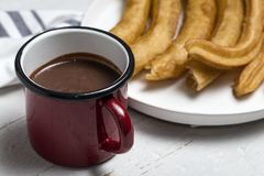 Churros com chocolate quente Fotografia de Stock Royalty Free