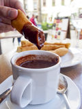 Churros Con Chocolate. Is a popular Spanish dessert of fried sticks dipped in hot chocolate Stock Photos